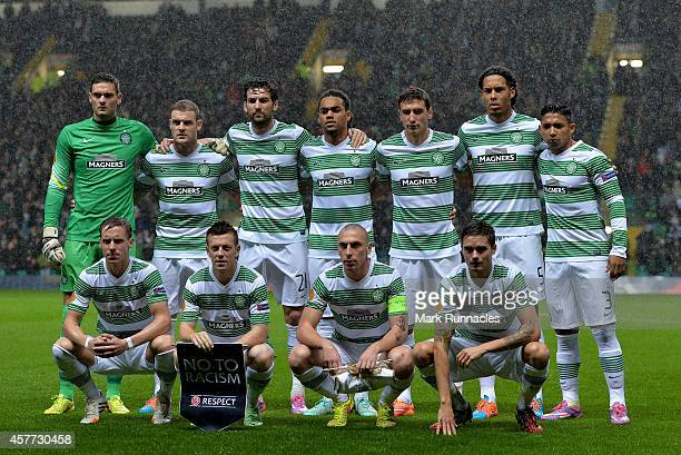 The Celtic team pose for a group photograph during the heavy rain at the start of the UEFA Europa League group D match between Celtic FC and FC Astra...