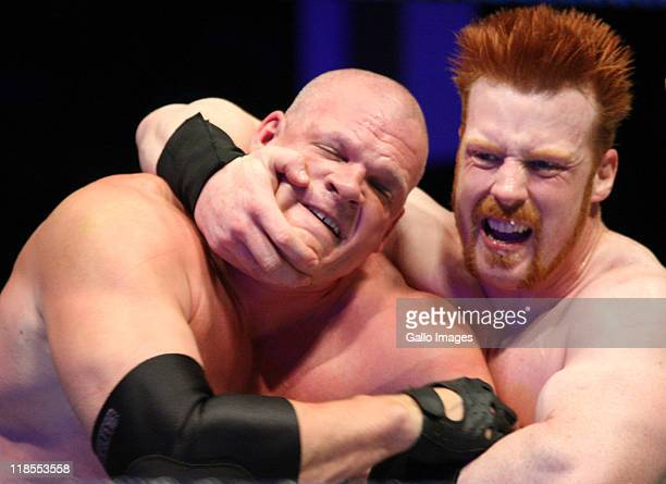 The Celtic Warrior Sheamus locks up with the Big Red Monster Kane during the WWE Smackdown Live Tour at Westridge Park Tennis Stadium on July 08 2011...