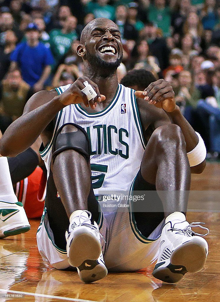 The Celtics' Kevin Garnett and the Bulls' Jimmy Butler hit the floor during a fourth quarter loose ball scramble, and when Garnett got the ball to teammate Brandon Bass, not pictured, out of the scrum, Bass was fouled by Chicago's Joakim Noah, not pictured, which brought a scream of delight from Garnett, seen here, that turned into a satisfied smile. The Boston Celtics hosted the Chicago Bulls in an NBA regular season basketball game at the TD Garden.
