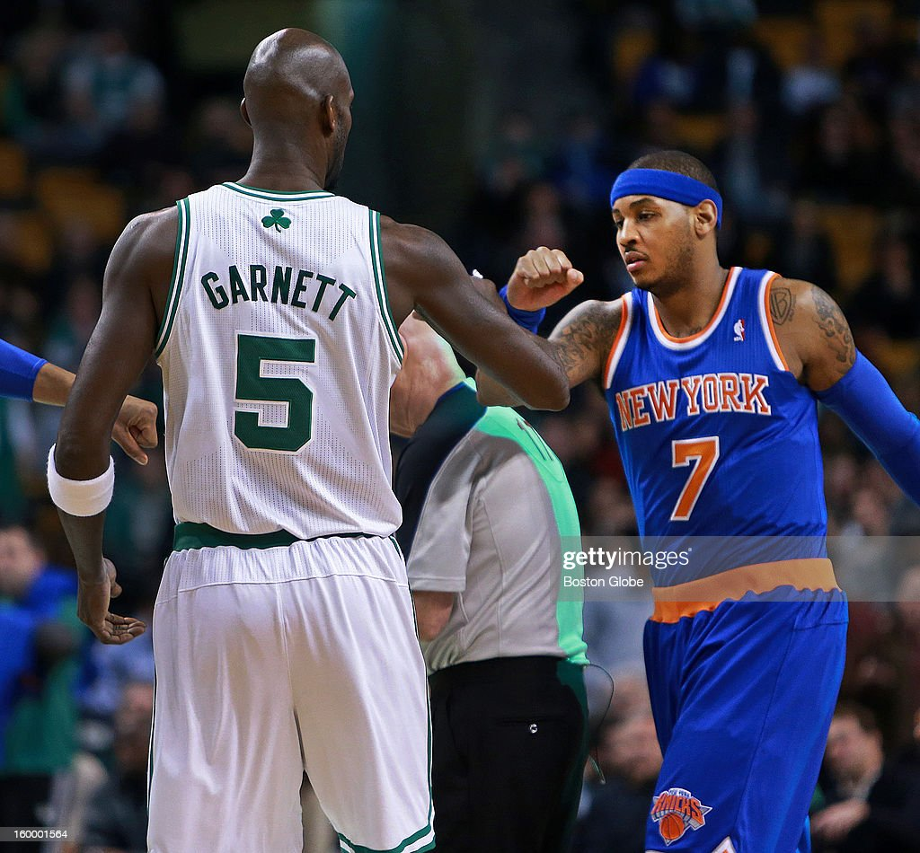 The Celtics' Kevin Garnett, left, and the Knicks' Carmelo Anthony, right, greet each other at center court before the opening tap off as the Boston Celtics hosted the New York Knicks in an NBA regular season game at TD Garden.