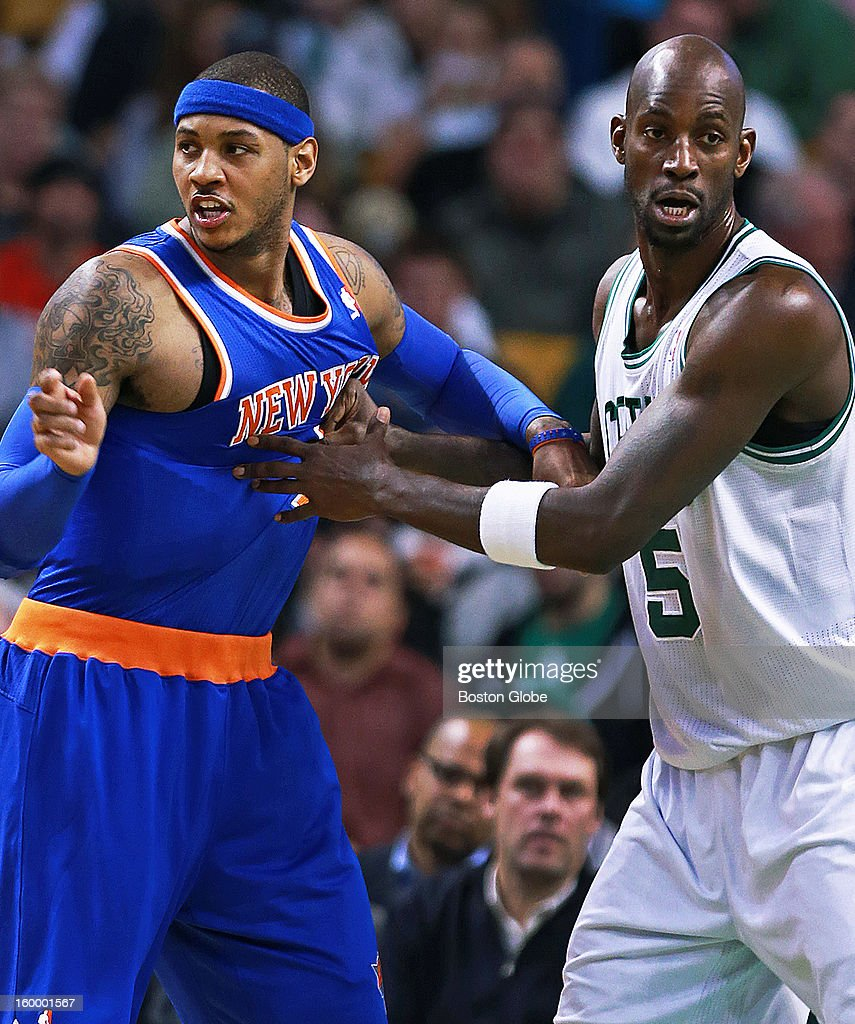 The Celtics' Kevin Garnett, right, plays some hands on defense against the Knicks' Carmelo Anthony, left, in the first half as the Boston Celtics hosted the New York Knicks in an NBA regular season game at TD Garden.