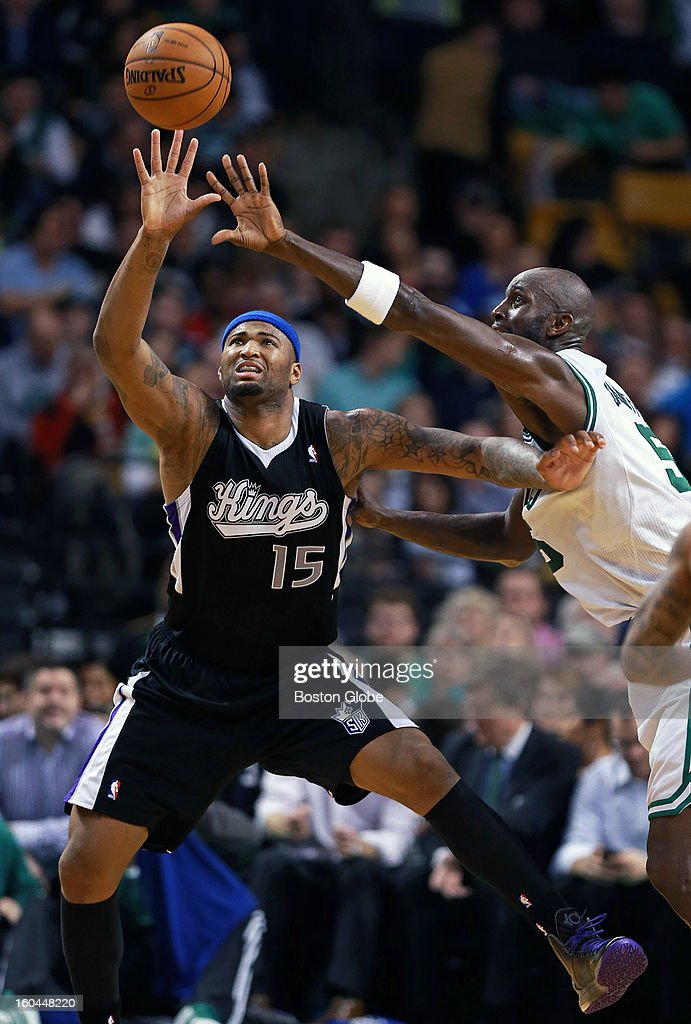 The Celtics' Kevin Garnett, right, reaches in to try to stop a pass from getting to the Kings' DeMarcus Cousins during first half action as the Boston Celtics hosted the Sacramento Kings in an NBA regular season game at the TD Garden.