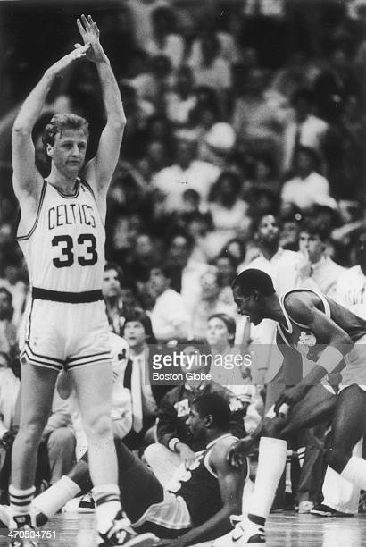 The Celtics' Larry Bird calls a time out after the foul as the Boston Celtics play the Los Angeles Lakers in an NBA finals game at Boston Garden on...