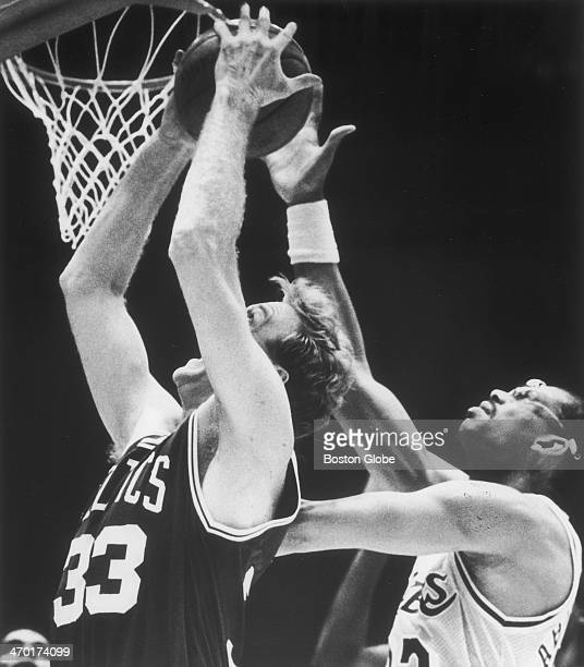 The Celtics' Larry Bird goes up for two with the Lakers' Kareem AbdulJabbar up over his shoulder as the Boston Celtics play the Los Angeles Lakers at...