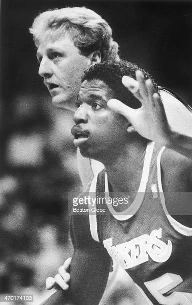 The Celtics' Larry Bird guards the Lakers' A C Green as the Boston Celtics play the Los Angeles Lakers at Boston Garden on June 4 1987