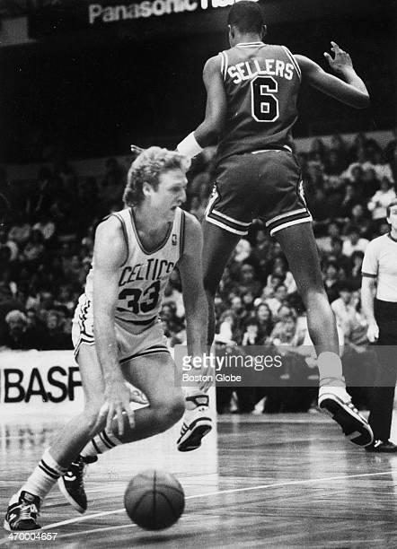 The Celtics' Larry Bird sneaks around the Bulls' Brad Sellers as the Boston Celtics play the Chicago Bulls at Boston Garden on Jan 2 1987