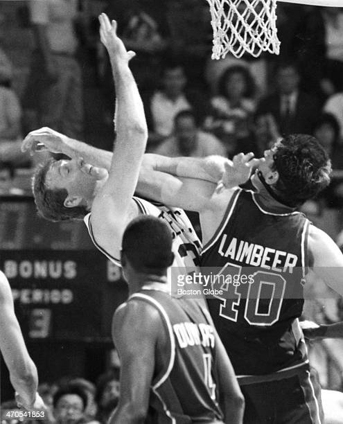 The Celtics' Larry Bird takes an arm in the face from the Pistons Bill' Laimbeer as the Detroit Pistons play the Boston Celtics at Boston Garden on...