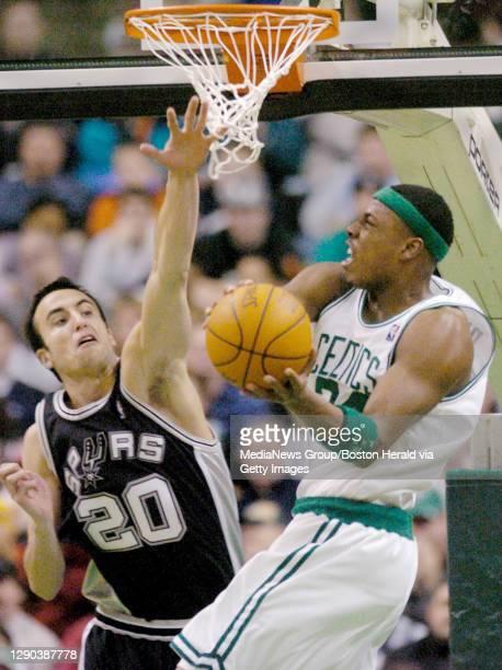 The Celtics' Paul Pierce goes against the Spurs' Emanuel Ginobili on Sunday at the Fleet Center.
