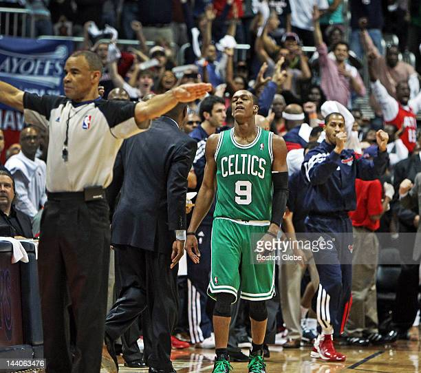 The Celtics Rajon Rondo reacts as a referee signals that time has expired  in the game 56c81f76c