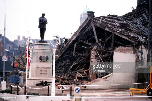 The Cenotaph at Enniskillen with the devastated community centre in the background 11 people died and more than 50 were injured in a massive IRA bomb...
