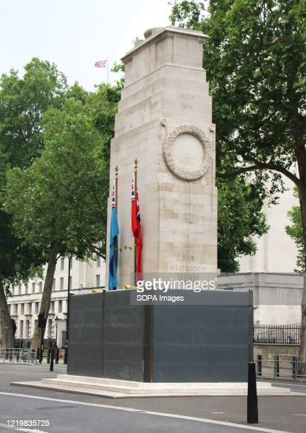 The Cenotaph in Whitehall is boarded up after being the target of graffiti by protesters recently. Several of London's historic statues have been...