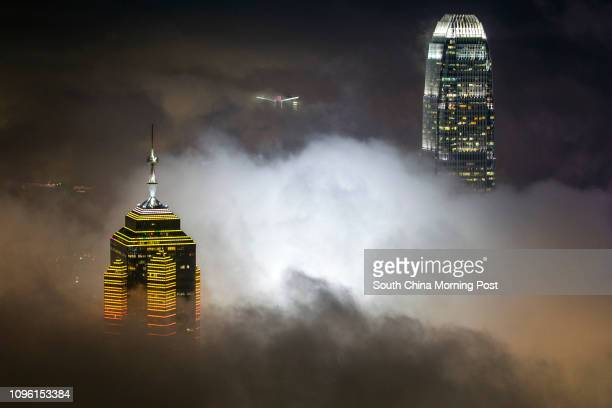 The Center and Two IFC are seen under foggy weather from The Peak 05APR16 SCMP/Bruce Yan