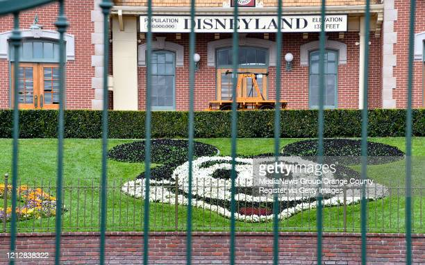 The center gate at the entrance to Disneyland is shut in Anaheim, CA, on Monday, Mar 16, 2020. The entire Disneyland Resort is shutting down due to...