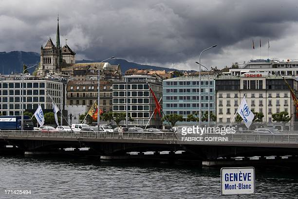 The center of the city of Geneva with the Mont Blanc Bridge and the Cathedrale Stpierre as backgound is seen under clouds on June 14 2013 AFP PHOTO /...