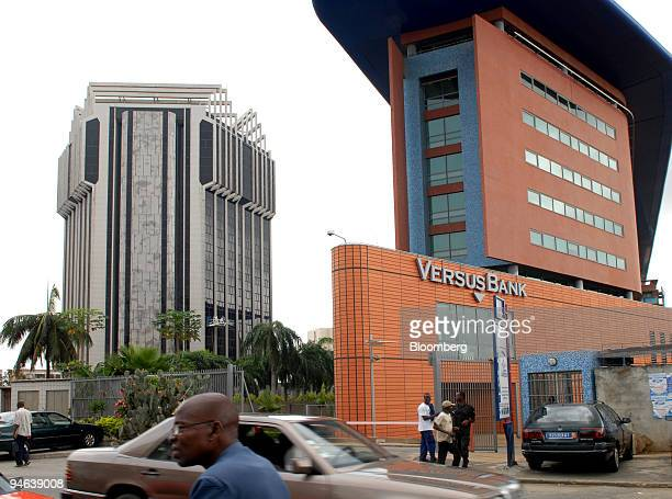 The Central Bank of West African States left sits with the Versus Bank building in the financial district of Abidjan Ivory Coast on Tuesday Dec 11...
