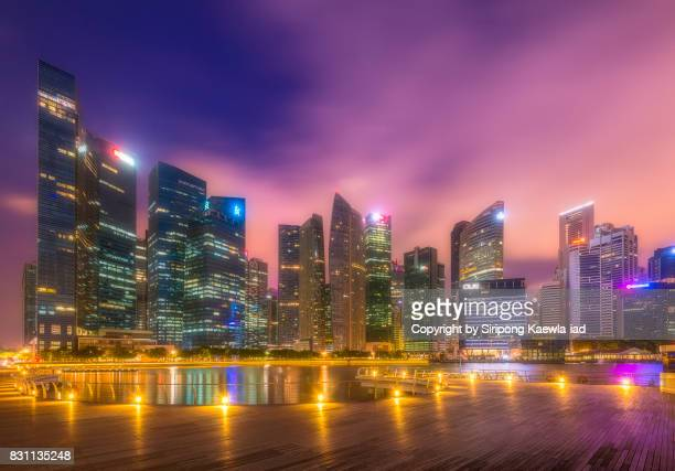 The Central Business District (CBD) Buildings around the Marina Bay in Singapore at dawn.