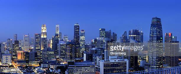 The central business district skyline is seen in this stitched composite panoramic image in Singapore on Monday Aug 8 2011 Singapore reduced the top...