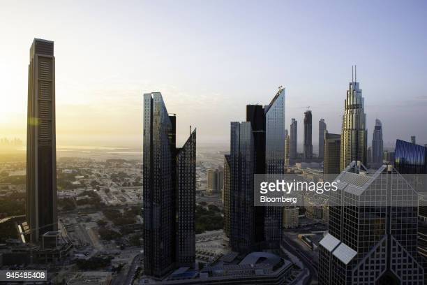 The Central Park Towers center stand at the Dubai International Financial Center in Dubai United Arab Emirates on Wednesday April 11 2018 Transformed...
