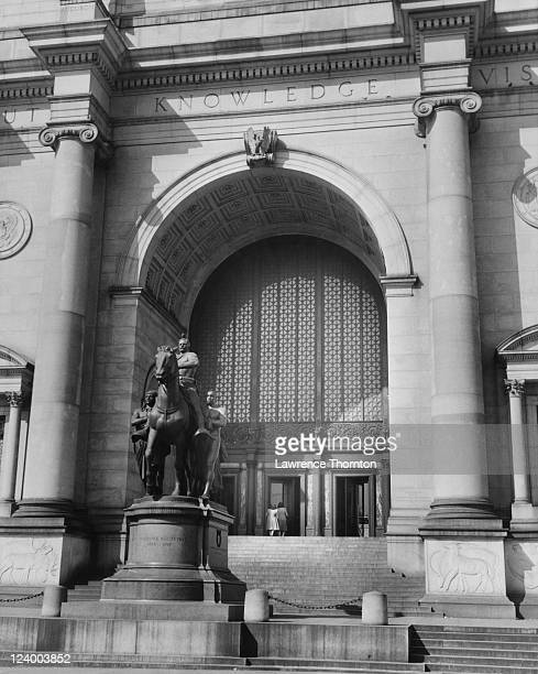 The Central Park West entrance of the American Museum of Natural History in Manhattan New York City circa 1950 On the left is the New York State...
