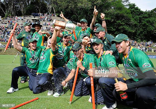 The Central Stags celebrate with the trophy after they won the HRV Twenty20 cricket match over the Auckland Aces at Pukekura Park on January 31 2010...