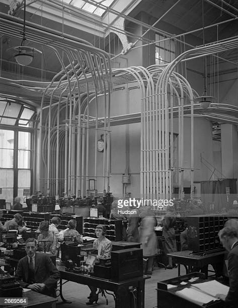 The Central Telegraph Office in London through which 50000 telegrams pass every year is manned by 3000 staff who sit amid buzzing and humming...
