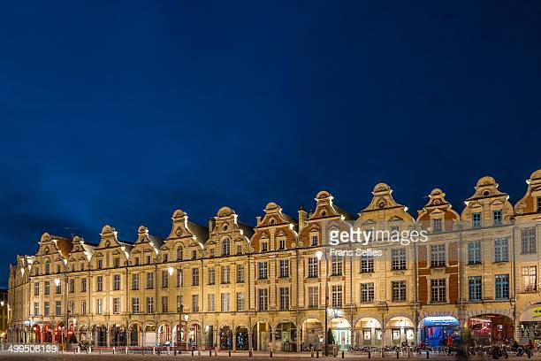 The centre of the town of Arras is marked by two large squares, the Grande Place and the Place des Héros, also called the Petite Place. These are...