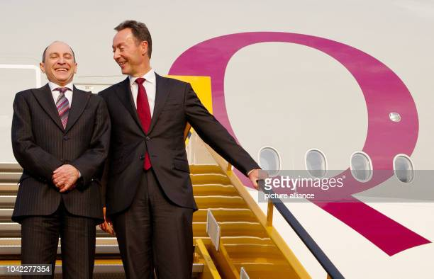 The CEO and president of airplane manufacturer Airbus Fabrice Bregier and the CEO of Quatar Airways Akbar Al Baker stand on a gangway in front of an...