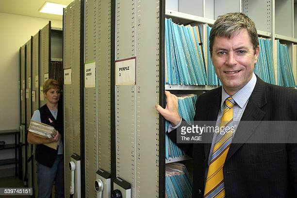 The CEO of Dianella Community Health Mark Sullivan He is pictured with many of the patient files which are being stored electronically using wireless...