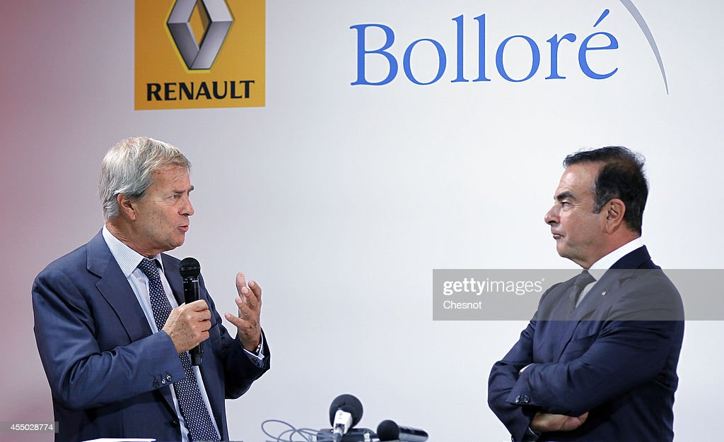 The CEO of French carmaker Renault, Carlos Ghosn (R) and French industrial group Bollore head Vincent Bollore (L) give a press conference at the Atelier Renault on September 9, 2014, in Paris, France. Carlos Ghosn announced that Renault would manufacture in the northwestern French city of Dieppe the Bollore's Bluecar electric vehicle.