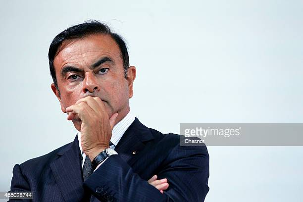 The CEO of French carmaker Renault Carlos Ghosn attends a press conference with French industrial group Bollore head Vincent Bollore at the Atelier...