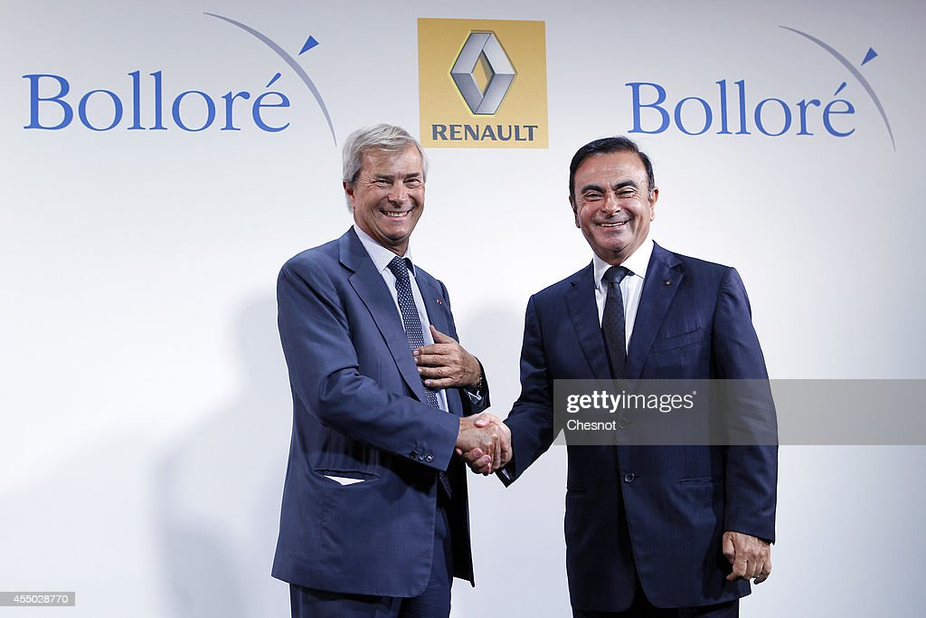 The CEO of French carmaker Renault, Carlos Ghosn (R), shakes hands with French industrial group Bollore's head Vincent Bollore at the end of a press conference at the Atelier Renault on September 9, 2014, in Paris, France. Carlos Ghosn announced that Renault would manufacture in the northwestern French city of Dieppe the Bollore's Bluecar electric vehicle.