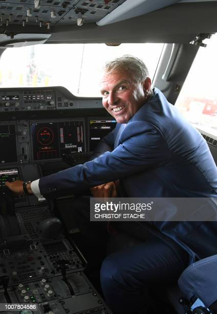 The CEO of German airline Lufthansa Carsten Spohr poses in the cockpit of the tenth Lufthansa Airbus A350900 during a naming ceremony of the aircraft...