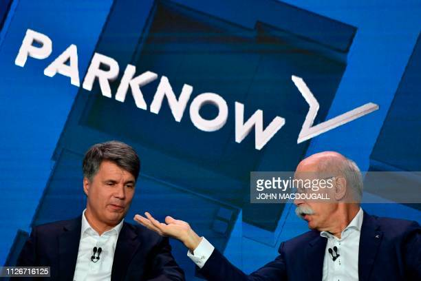 The CEO of German auto giant Daimler AG Dieter Zetsche and CEO of German carmaker BMW Harald Krueger present the merger of their car sharing...