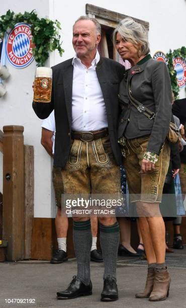 The CEO of German first division Bundesliga football club Bayern Munich KarlHeinz Rummenigge and his wife Martina Rummenigge wear traditional...