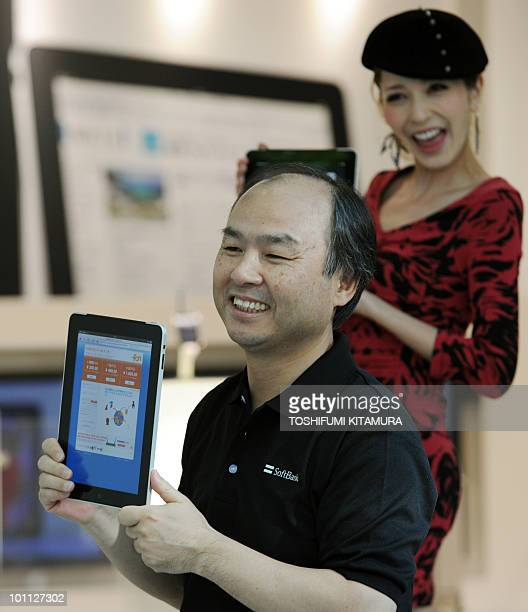 The CEO of Japanese internet service provider Softbank Apple's exclusive partner in Japan Masayoshi Son and fashion model singer and actress Lena...