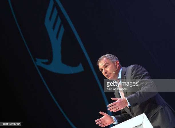 The CEO of Lufthansa Carsten Spohr speaking at the launch event for its new Airbus A350900 aircraft under a company logo in Munich Germany 02...