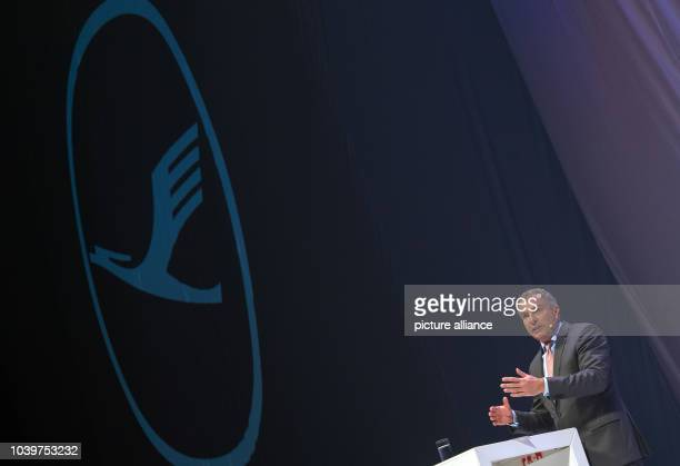 The CEO of Lufthansa Carsten Spohr speaking before the beginning of the christening event for its new Airbus A350900 aircraft under a company logo in...