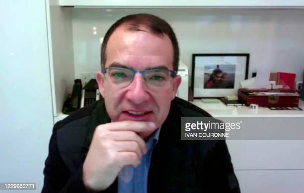 The CEO of Moderna Stéphane Bancel is seen in this video frame grab as he speaks during an interview with AFP on November 17, 2020. - The CEO of...