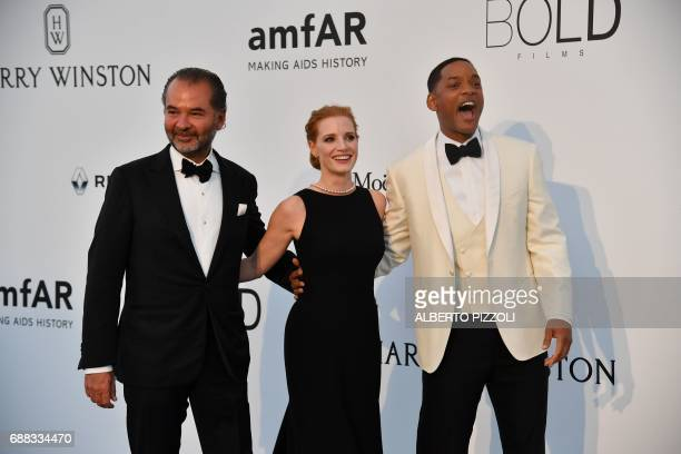 The CEO of Moncler Remo Ruffini US actress Jessica Chastain and US actor Will Smith arrive for the amfAR's 24th Cinema Against AIDS Gala on May 25...