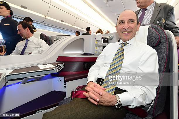 The CEO of Qatar Airways, Akbar Al Baker, poses aboard an A350 during an hour flight over France on December 22, 2014. Airbus delivered its first...