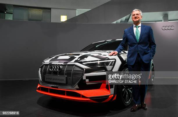 The CEO of the German carmaker Audi AG Rupert Stadler poses next to an Audi etron prototype car prior to annual press conference at the headquarters...