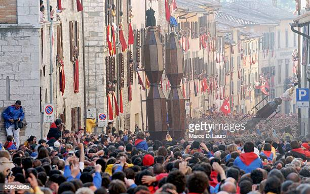 The ceraioli run as they carry the candles during the Corsa dei Ceri on May 15 2004 in Gubbio 208 km northeast of Rome Italy Gubbio's Race of the...