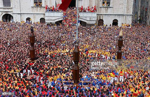 The ceraioli run three times around Piazza Grande as they carry the candles prior to the Corsa dei Ceri on May 15 2004 in Gubbio 208 km northeast of...