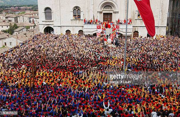 The Ceraioli wave as they wait for the three candles to exit from Palazzo dei Consoli prior to the Corsa dei Ceri on May 15 2004 in Gubbio 208 km...