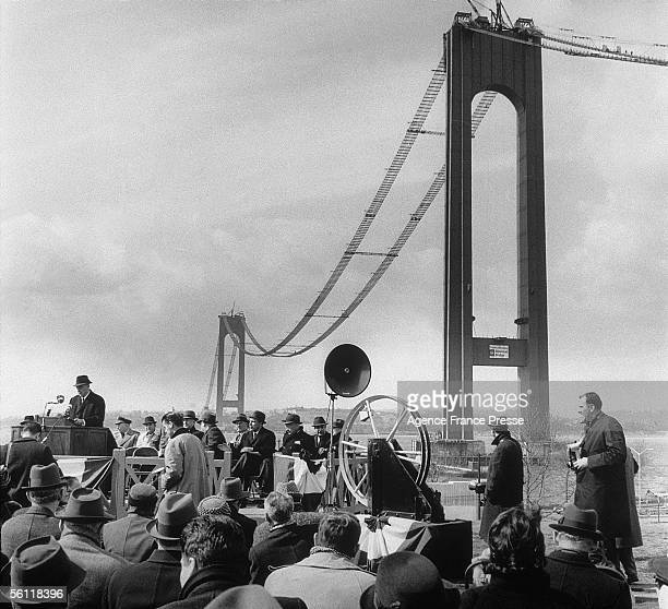 The ceremony marking the beginning of the spinning of the steel cables for the Verrazano Bridge which links Brooklyn and Staten Island New York The...