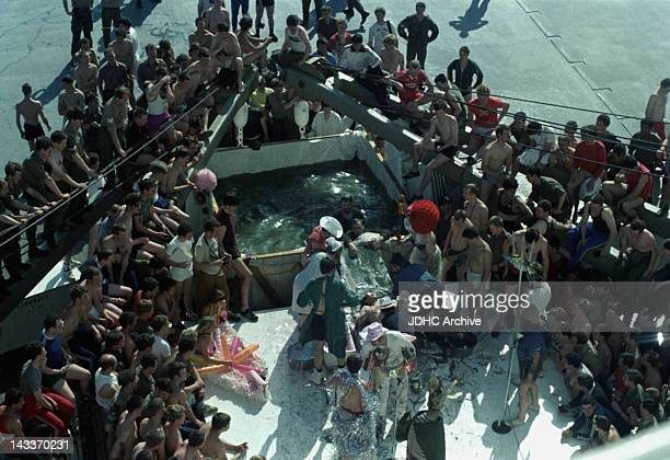 The ceremony of Crossing The Line takes place on board the Cunard liner 'RMS Queen Elizabeth 2' as she crosses the equator May 1982 She has been...