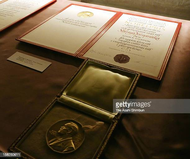 The certificate and medal of the Nobel Prize in Medicine laureate Shinya Yamanaka are seen ahead of the Nobel Prize Award Ceremony at Concert Hall on...