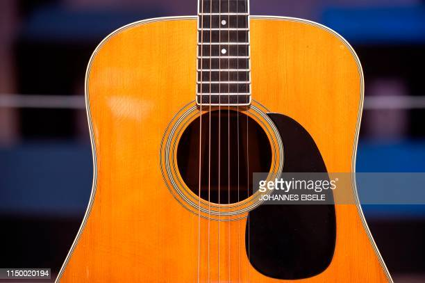 """The C.F Martin & Company, Nazareth Acoustic Guitar, used to record """"Wish You Were Here"""" is on display at Christie's on June 14, 2019 in New York..."""