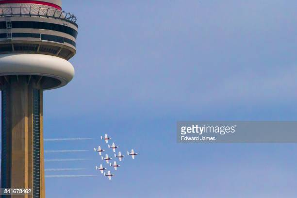 The CF Snowbirds fly past the CN Tower during the on 68th annual Canadian International Air Show during Canada's 150th anniversary year on September...