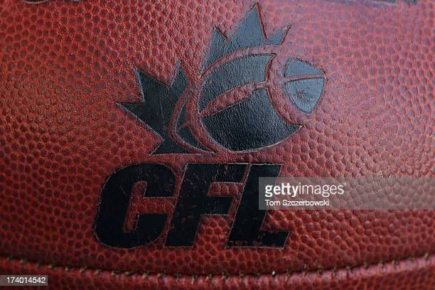 The CFL logo on an official Canadian CFL league ball during warmups before the Saskatchewan Roughriders CFL game against the Toronto Argonauts on...